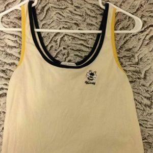 A yellow tank top with embroidery